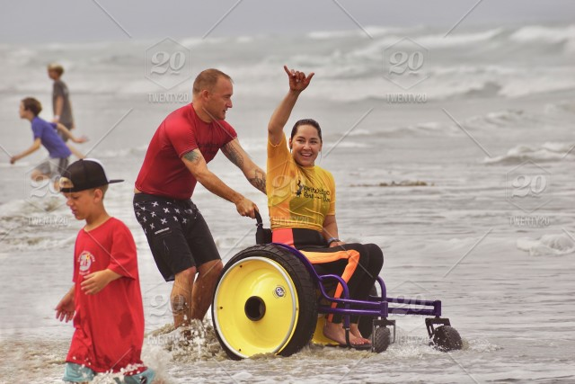 wheelchair on beach-0412c862-f92c-453b-ae97-1f13ad929df2